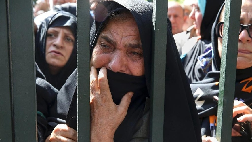In this Sunday, Oct. 4, 2015, file photo, an Iranian mourner weeps during a funeral ceremony, attended by thousands of mourners in Tehran, Iran, for some of the pilgrims who were killed in a stampede during the hajj pilgrimage in Saudi Arabia in September 2015. The crush and stampede outside the holy city of Mecca killed at least 1,399 people from around the world during the hajj pilgrimage, a new tally released on Thursday, Oct. 8, showed, more than 600 more than the kingdom's official toll. (AP Photo/Vahid Salemi, File)