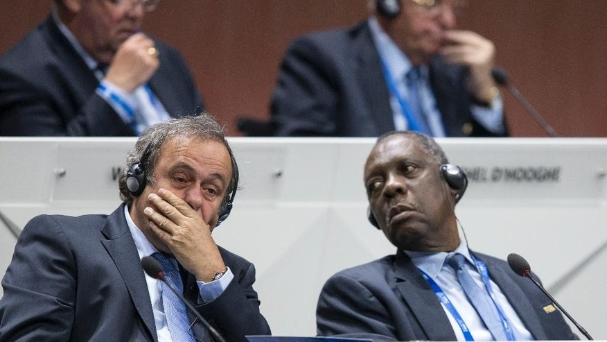 FILE - In this Friday, May 29, 2015, file photo, UEFA president Michel Platini, left, and FIFA senior vice president Issa Hayatou look on during the 65th FIFA Congress held at the Hallenstadion in Zurich, Switzerland. On Thursday, Oct. 8, 2015 FIFA provisionally banned President Sepp Blatter and UEFA President Michel Platini for 90 days. (Patrick B. Kraemer/Keystone via AP, File)