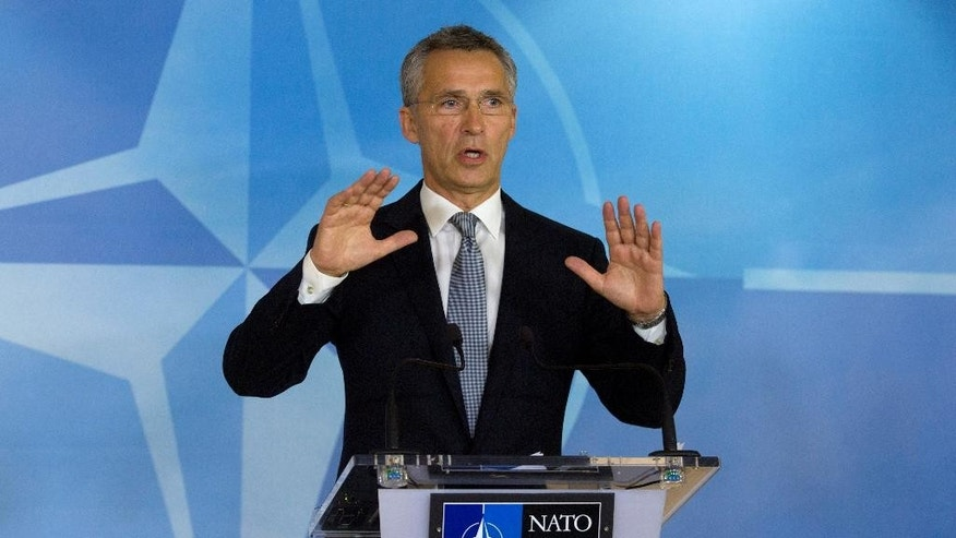 NATO Secretary General Jens Stoltenberg speaks during a media conference at NATO headquarters in Brussels on Thursday, Oct. 8, 2015. NATO defense ministers meet Thursday to consider the implications of recent Russian military actions in Syria, as well as ongoing measures to retool NATO to meet contemporary security threats. (AP Photo/Virginia Mayo)