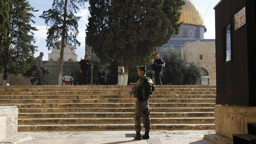 Israeli police stands guard at the entrance to Al-Aqsa compound in Jerusalem's Old City Thursday, Oct. 8, 2015.  Israeli Prime Minister Benjamin Netanyahu has barred all Cabinet ministers and lawmakers from visiting a sensitive Jerusalem holy site, fearing any high-profile spectacle could further enflame tensions that have gripped the country for weeks, an Israeli official said Thursday. The Jerusalem hilltop compound lies at the heart of recent tensions. It's revered by Muslims as the spot where Prophet Muhammad ascended to heaven and by Jews as the site of the two Jewish biblical Temples. (AP Photo/Mahmoud Illean)