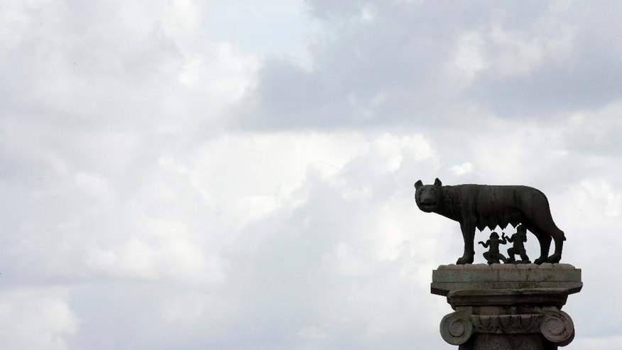 Clouds float over the bronze statue of a she-wolf nursing the infants Romulus and Remus, symbol of Rome, outside Rome's Campidoglio Capitol Hill, Thursday, Oct. 8, 2015. Rome's embattled mayor, Ignazio Marino, was under mounting pressure Thursday to resign following a scandal over his expense accounts that threatened to be the final straw in a months-long campaign by his opponents to get him out of office. (AP Photo/Alessandra Tarantino)