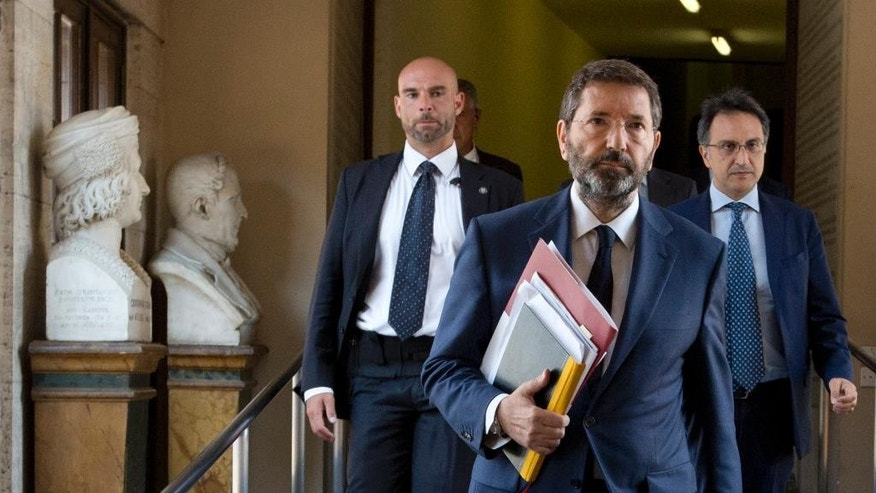 FILE -- In this file photo taken on July 25, 2015, Rome Mayor Ignazio Marino arrives at Rome's Campidoglio Capitol Hill. Rome Mayor Ignazio Marino resigned Thursday, Oct 8, 2015, following a scandal over his expense accounts that became the final straw in a months-long campaign by opponents inside and out of his Democratic Party to force him from office.(AP Photo/Alessandra Tarantino)