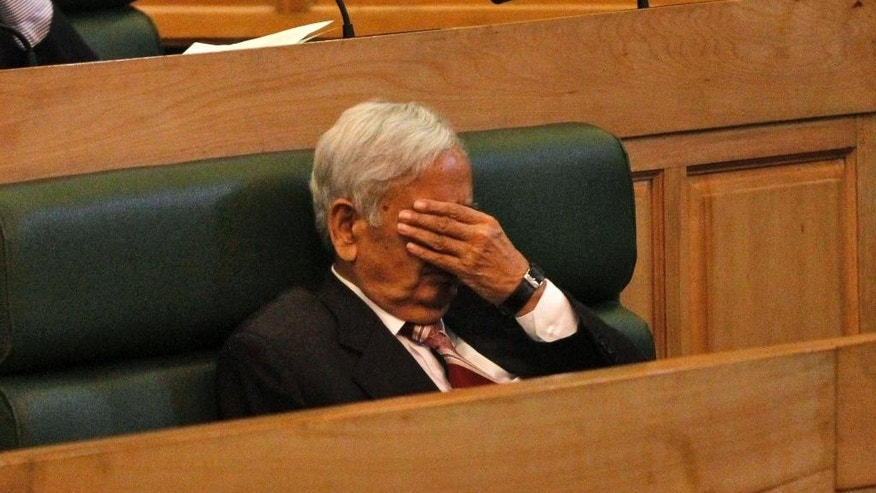 Chief Minister of Jammu and Kashmir state Mufti Mohammad Sayeed gestures as he sits inside the state legislature house in Srinagar, Indian controlled Kashmir, Thursday, Oct. 8, 2015. Lawmakers from India's ruling Hindu nationalist party Bharatiya Janata Party (BJP) in Kashmir kicked and punched Rashid Ahmed, independent member of the state assembly, on Thursday for hosting a party where he served beef. Hindus consider cows to be sacred, and slaughtering the animals is banned in most Indian states. (AP Photo/Mukhtar Khan)