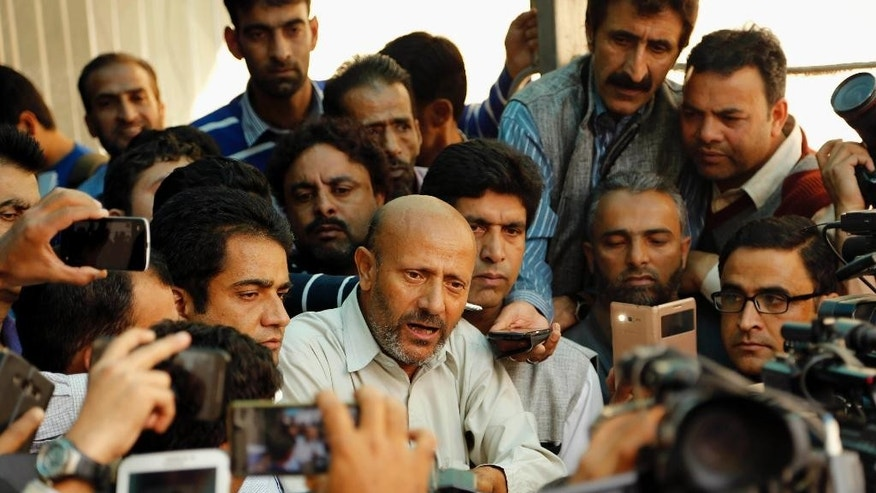 Engineer Rashid Ahmed, a Jammu and Kashmir state lawmaker, speaks to the media in Srinagar, Indian controlled Kashmir, Thursday, Oct. 8, 2015. Lawmakers from India's ruling Hindu nationalist party Bharatiya Janata Party (BJP) in Kashmir kicked and punched Ahmed, independent member of the state assembly on Thursday for hosting a party where he served beef. Hindus consider cows to be sacred, and slaughtering the animals is banned in most Indian states. (AP Photo/Mukhtar Khan)