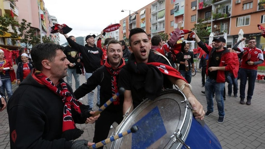 Albanian soccer fans chat slogans before the group I Euro 2016 qualifying match between Albania and Serbia in Elbasan, central Albania, Thursday, Oct. 8, 2015. (AP Photo/Visar Kryeziu)