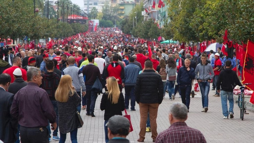 Albanian soccer fans gather outside Elbasan Arena before the group I Euro 2016 qualifying match between Albania and Serbia in Elbasan, central Albania, Thursday, Oct. 8, 2015. Serbian Prime Minister Aleksandar Vucic says he will not attend a European Championship qualifier in Albania, saying he did not want heated fan rivalry to undermine progress made in improving relations between the two Balkan countries.(AP Photo/Visar Kryeziu)