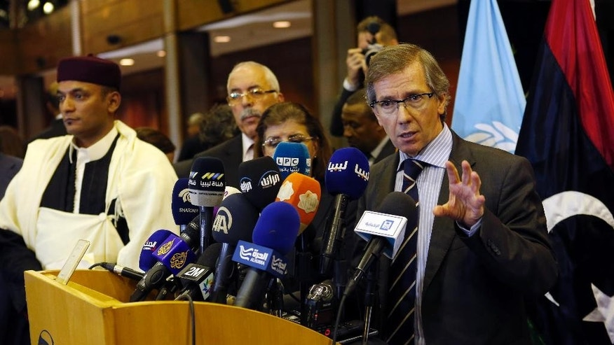 United Nations envoy for Libya Bernardino Leon, right, gestures as he makes an announcement to the media in Skhirat, Morocco, Thursday, Oct. 8, 2015. The U.N. envoy for Libya has proposed a national unity government for Libya after months of difficult talks between the north African country's two rival governments, but now it's up to the two sides and Libyans themselves to approve it. (AP Photo/Abdeljalil Bounhar)