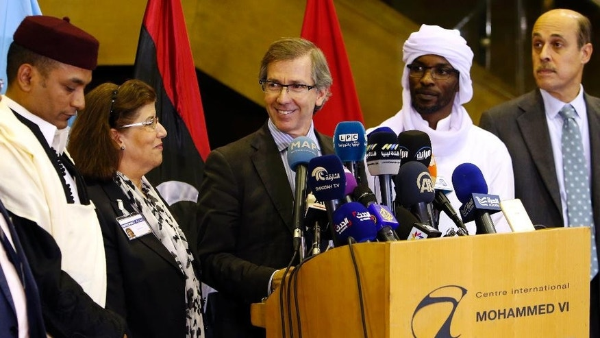 United Nations envoy for Libya Bernardino Leon, center, makes an announcement to the media in Skhirat, Morocco, Thursday, Oct. 8, 2015. The U.N. envoy for Libya has proposed a national unity government for Libya after months of difficult talks between the north African country's two rival governments, but now it's up to the two sides and Libyans themselves to approve it. (AP Photo/Abdeljalil Bounhar)