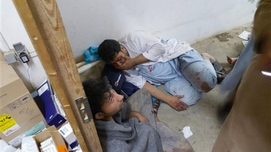 Injured Doctors Without Borders staff are seen after explosions near their hospital in the northern Afghan city of Kunduz, Saturday, Oct. 3, 2015.  (Médecins Sans Frontières via AP)