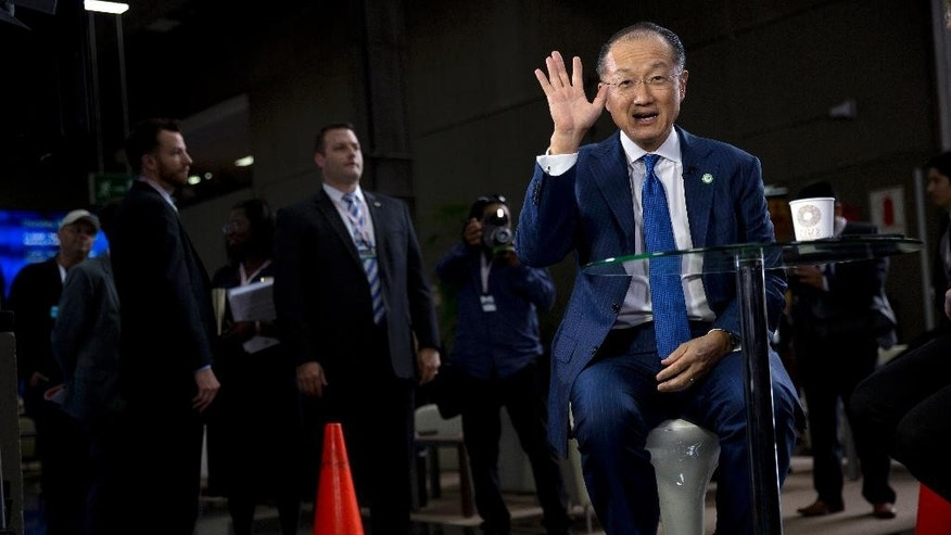 World Bank President Jim Yong Kim greets reporters before the start of an interview in Lima, Peru, Thursday, Oct. 8, 2015. The world's finance ministers and central bankers are in Lima for the joint annual meetings of the World Bank and IMF that run through Sunday. (AP Photo/Rodrigo Abd)