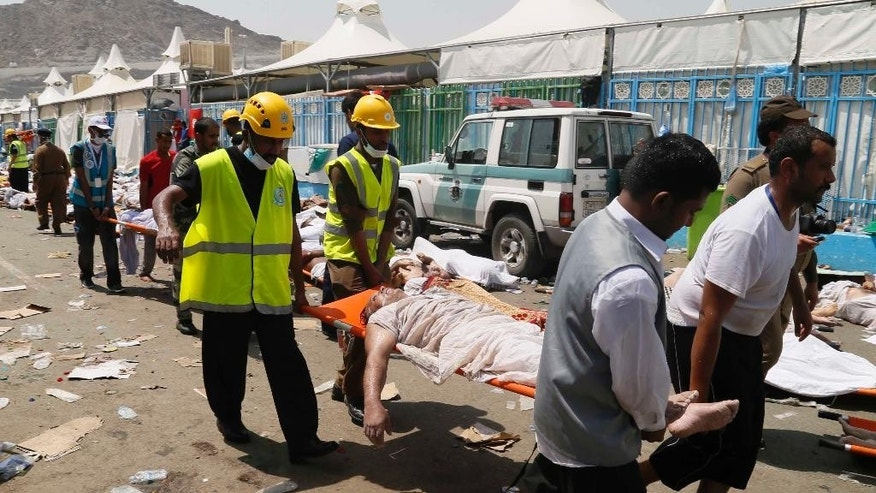 Sept. 24, 2015- FILE photo of emergency workers attending to victims of a stampede in Mina, Saudi Arabia during the annual hajj pilgrimage. A new tally shows last month's crush and stampede at the Saudi hajj was the deadliest event to ever strike the annual pilgrimage.