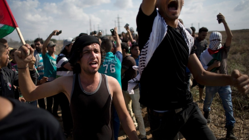 Oct. 9, 2015 - Angry Palestinian protesters call for ambulances to evacuate wounded people, during clashes with Israeli soldiers on the Israeli border Eastern Gaza City.