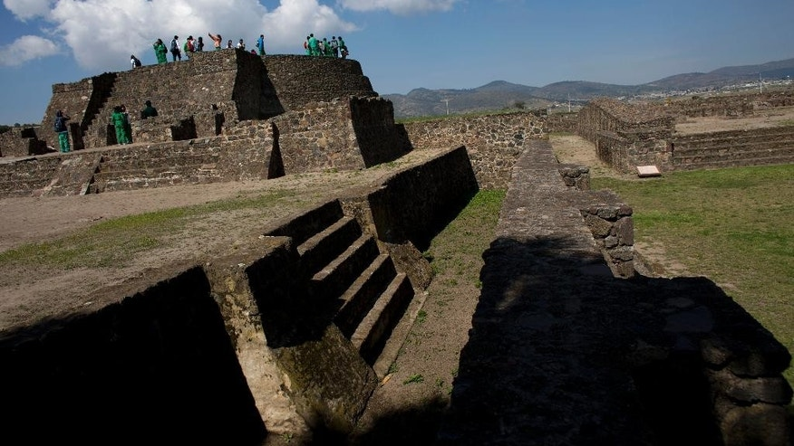 Students stand on a temple at the Zultepec-Tecoaque archeological site in Tlaxcala state, Mexico Thursday, Oct. 8, 2015. New excavations here, the site of one of the Spanish conquistadors' worst defeats in Mexico, are yielding new evidence about what happened when two cultures clashed, and the native Mexicans, at least temporarily, were in control. (AP Photo/Rebecca Blackwell)