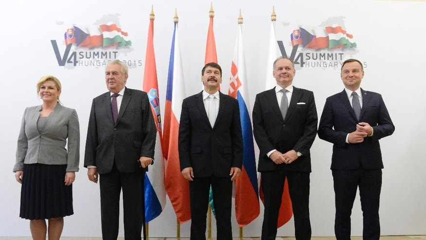 Presidents Kolinda Grabar-Kitarovic of Croatia, Milos Zeman of the Czech Republic, Janos Ader of Hungary, Andrej Kiska of Slovakia and Andrzej Duda of Poland, left to right, pose for a group photo during the meeting of heads of state of the Visegrad Group countries in Balatonfured, 125 km southwest of Budapest, Hungary, Friday, Oct. 9, 2015. (Tamas Kovacs/MTI via AP)