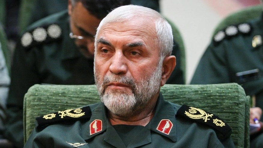 "In this Dec. 9, 2009 photo, released by Iranian Tasnim News Agency, Iranian Revolutionary Guard Gen. Hossein Hamedani sits in a meeting in Tehran, Iran. Hamedani, a senior commander in Iran's powerful Revolutionary Guard was killed by Islamic State extremists on the outskirts of the northern Syrian city of Aleppo, Iranian state media reported on Friday. A state television report said that Gen. Hossein Hamedani was killed in the suburbs of Aleppo while ""carrying out an advisory mission.""  (AP Photo/Tasnim News Agency, Hamed Malekpour)"