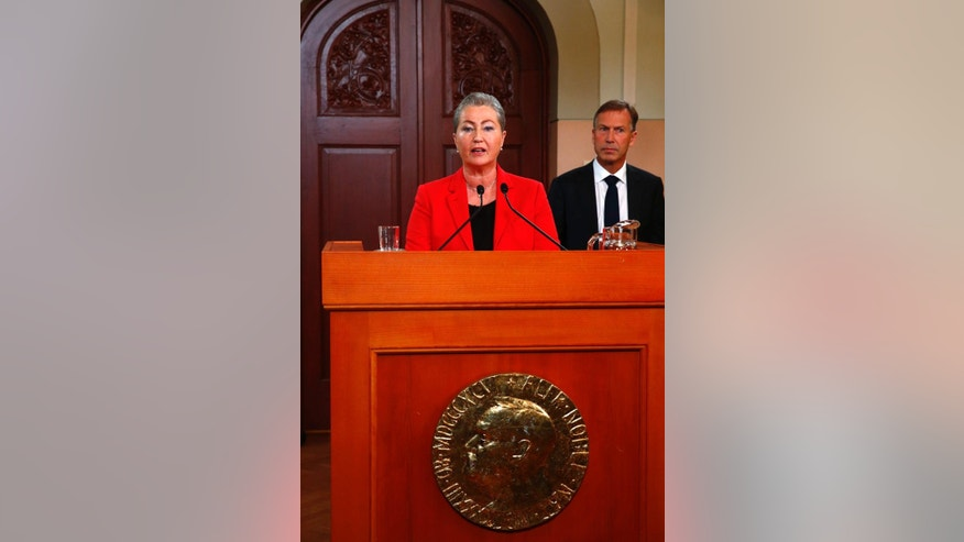 Kaci Kullmann Five, the new head of the Norwegian Nobel Peace Prize Committee, announces the winner of 2015 Nobel peace prize during a press conference in Oslo, Norway, Friday Oct. 9, 2015. The Norwegian Nobel Committee announced Friday that the 2015 Nobel Peace Prize was awarded to the Tunisian National Dialogue Quartet. (Heiko Junge/NTB scanpix via AP)  NORWAY OUT
