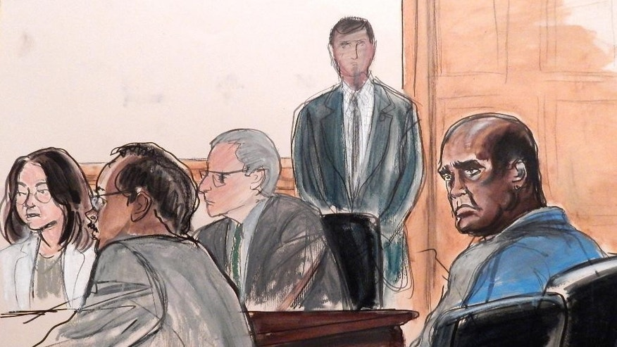"FILE - In this Oct. 6, 2015, courtroom sketch, defendant John Ashe, right, sits in court during his arraignment on bribery charges in New York, Tuesday, Oct. 6, 2015. The former president of the United Nations General Assembly turned the world body into a ""platform for profit"" by accepting over $1 million in bribes from a billionaire Chinese real estate mogul and other businesspeople to pave the way for lucrative investments, a prosecutor charged Tuesday. Seated from left are co-defendant Sheri Yan, defense attorney Robert Van Lierop and defense attorney Mark Kirsch. (Elizabeth Williams via AP, File)"