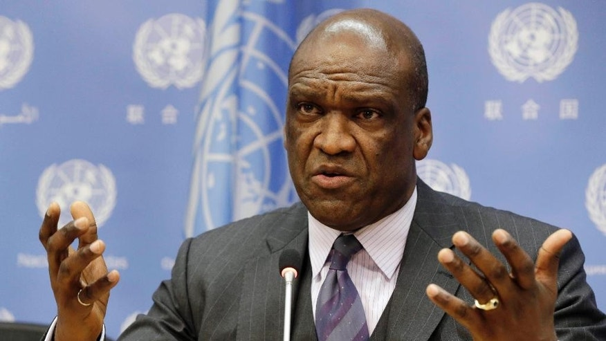 FILE - In this Sept. 17, 2013, file photo, Ambassador John Ashe, of Antigua and Barbuda, the president of the General Assembly's 68th session, speaks during a news conference at United Nations headquarters. Ashe accepted more than $500,000 in bribes from a Chinese real estate mogul and other businesspeople in exchange for help obtaining lucrative investments and government contracts, according to federal court documents unsealed Tuesday, Oct. 6, 2015. (AP Photo/Richard Drew, File)