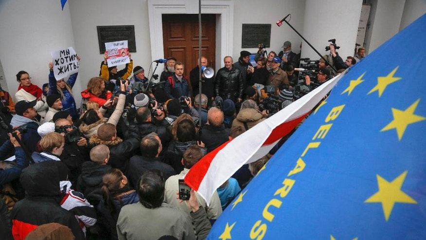 "Demonstrators wave a historical Belarus and European flags during an opposition ""March under national flags "" rally,  in Minsk, Belarus, Saturday, Oct. 10, 2015, a day ahead of scheduled presidential elections in Belarus.  (AP Photo/Dmitry Lovetsky)"