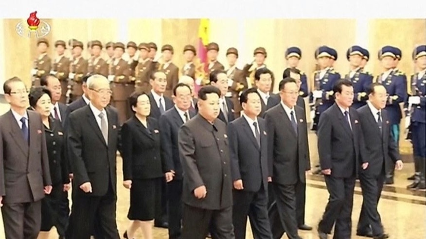 In this Oct. 10, 2015 image made from video, North Korean leader Kim Jong Un, center, visits the Kumsusan Palace of the Sun to pay respect to both his late father Kim Jong Il and grandfather at Kim Il Sung the Kumsusan Palace of the Sun in Pyongyang. North Korea is holding what is expected to be one of its biggest celebrations ever Saturday for the 70th anniversary of its ruling party's creation, an attention-getting event that is the government's way of showing the world and its own people the Kim dynasty — now in its third generation — is firmly in control and its military a power to be reckoned with.  (KRT via AP Video) TV OUT, NORTH KOREA OUT