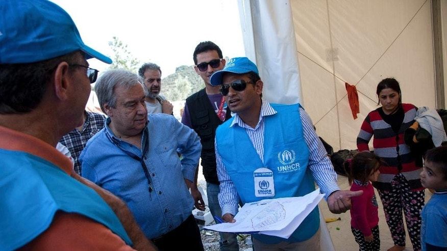 "United Nations High Commissioner for Refugees Antonio Guterres, second left, visits the Moria camp on the eastern Aegean island of Lesbos, Greece, Saturday Oct. 10, 2015. Greece's first ""hotspot,"" or migrant processing center, will open over the next 10 days, allowing migrants to be flown to other European Union countries, mostly of their preference, and have their asylum applications processed there, European Union officials say.  (AP Photo/Antonis Pasvantis)"