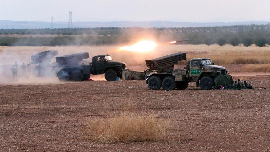 In this photo taken on Wednesday, Oct.  7, 2015, Syrian army rocket launchers fire near the village of Morek in Syria. The Syrian army has launched an offensive this week in central and northwestern Syria aided by Russian airstrikes. CIA-backed rebels in Syria, who had begun to put serious pressure on President Bashar Assad's forces, are now under Russian bombardment with little prospect of rescue by their American patrons, U.S. officials say. Over the past week, Russia has directed parts of its air campaign against U.S.-funded groups and other moderate opposition in a concerted effort to weaken them, the officials say.  (AP Photo/Alexander Kots, Komsomolskaya Pravda, Photo via AP)