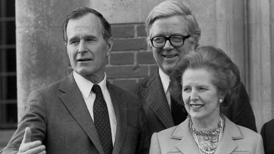 FILE - In this Feb. 12, 1984 file photo, US vice President George Bush, left, poses for a photograph with British Prime Minister Margaret Thatcher, right, and British Foreign Secretary Geoffrey Howe, in London. The family of Britain's former Treasury chief Geoffrey Howe says the longtime Conservative Party figure has died at his home. He was 88. The family said Saturday that he had died suddenly of a suspected heart attack late Friday night, Oct. 9, 2015,  at his home in Warwickshire, north of London. (PA via AP, File) UNITED KINGDOM OUT