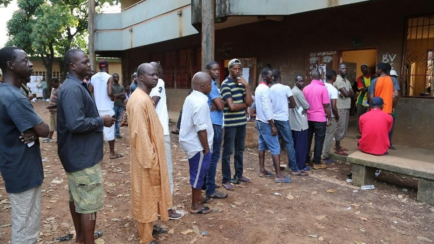 People queue to cast their votes during Presidential elections in Bambeto neighbourhood of Conakry, Guinea, Sunday Oct. 11, 2015. Hundreds lined up in Guinea and began voting in the country's second democratic presidential election in more than half a century. (AP Photo/Youssouf Bah)