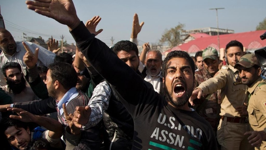 In this Friday, Oct. 9, 2015 photo, supporters of Engineer Rashid Ahmed, a Jammu and Kashmir state lawmaker, shout slogans during a protest against India's ruling Hindu nationalist party Bharatiya Janata Party (BJP) after lawmakers from the BJP kicked and punched Ahmed on Thursday for hosting a party where he served beef, in Srinagar, Indian controlled Kashmir. Hindus consider cows to be sacred, and slaughtering the animals is banned in most Indian states. Cows have long been sacred to Hindus, worshipped as a mother figure and associated since ancient times with the god Krishna. But increasingly, cows are also becoming a tool of political parties, an electioneering code word and a rallying cry for both Hindu nationalists and their opponents. (AP Photo/Dar Yasin)