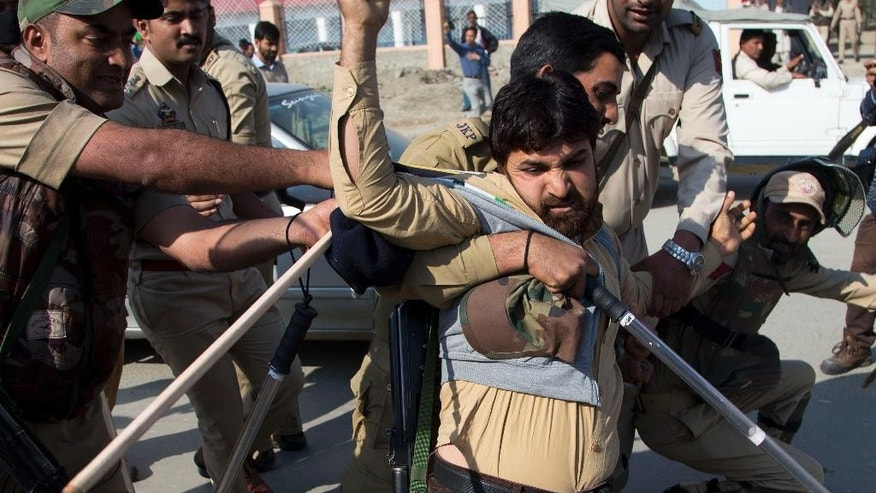 In this Friday, Oct. 9, 2015 photo, Indian policemen detain a supporter of Engineer Rashid Ahmed, a Jammu and Kashmir state lawmaker, during a protest against India's ruling Hindu nationalist party Bharatiya Janata Party (BJP) after lawmakers from the BJP kicked and punched Ahmed on Thursday for hosting a party where he served beef, in Srinagar, Indian controlled Kashmir. Hindus consider cows to be sacred, and slaughtering the animals is banned in most Indian states. Cows have long been sacred to Hindus, worshipped as a mother figure and associated since ancient times with the god Krishna. But increasingly, cows are also becoming a tool of political parties, an electioneering code word and a rallying cry for both Hindu nationalists and their opponents. (AP Photo/Dar Yasin)