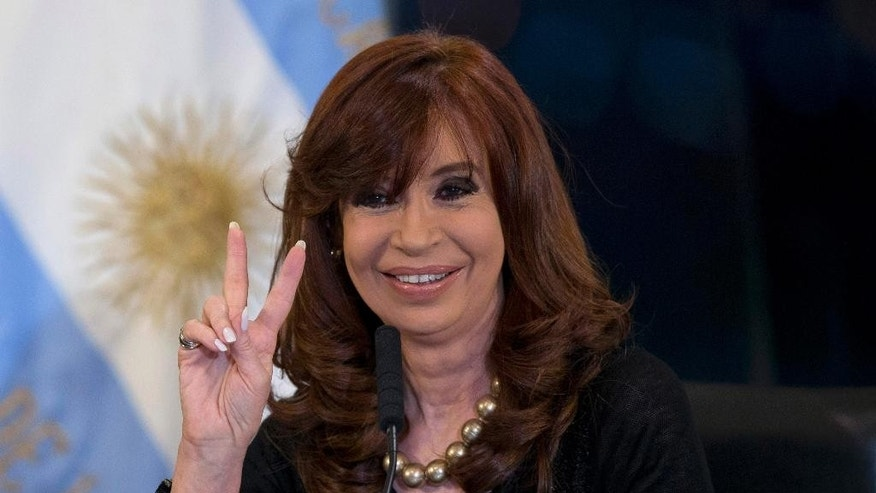 "FILE - In this Aug. 20, 2015, file photo, Argentina's President Cristina Fernandez flashes a victory sign during a ceremony at the government house in Buenos Aires, Argentina. The dispute between creditors and President Fernandez, who has refused to pay the $1.5 billion owed to hedge funds she refers to as ""vultures"" is preventing the country from accessing international credit markets. (AP Photo/Natacha Pisarenko)"