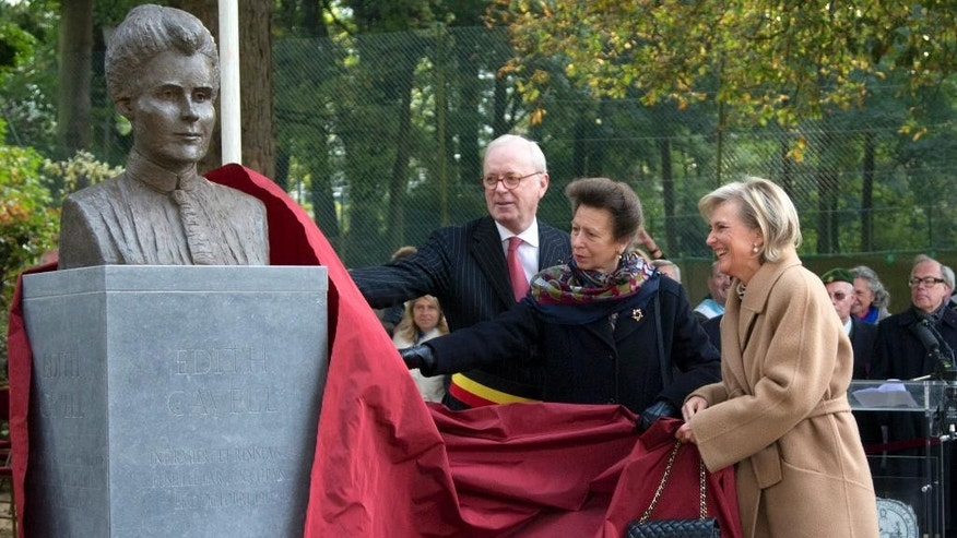 Britain's Princess Anne, center, and Belgium's Princess Astrid, right, unveil a bust of World War I nurse Edith Cavell during a commemoration service in Brussels on Monday, Oct. 12, 2015. Germany accused Cavell of helping injured Britons escape during the World War I and shot her at dawn on October 12, 1915. (AP Photo/Virginia Mayo)