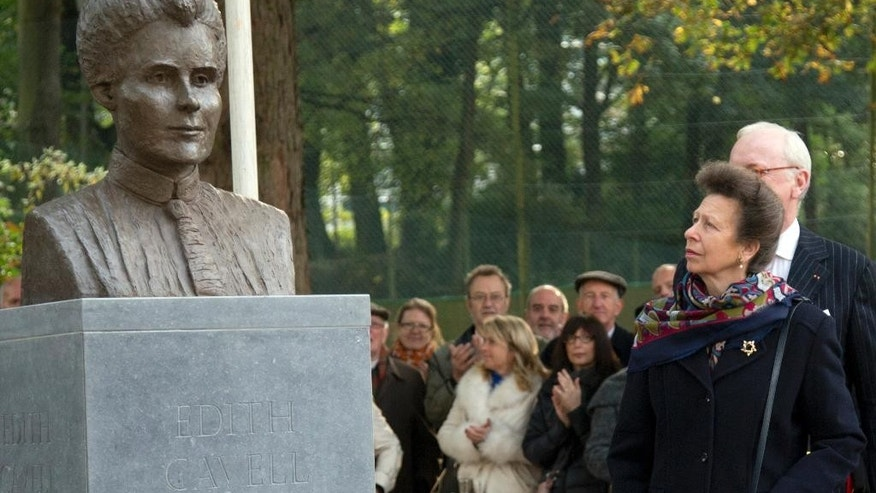 Britain's Princess Anne, second right, views a recently unveiled bust of World War I nurse Edith Cavell during a commemoration service in Brussels on Monday, Oct. 12, 2015. Germany accused Cavell of helping injured Britons escape during World War I and shot her at dawn on October 12, 1915. (AP Photo/Virginia Mayo)