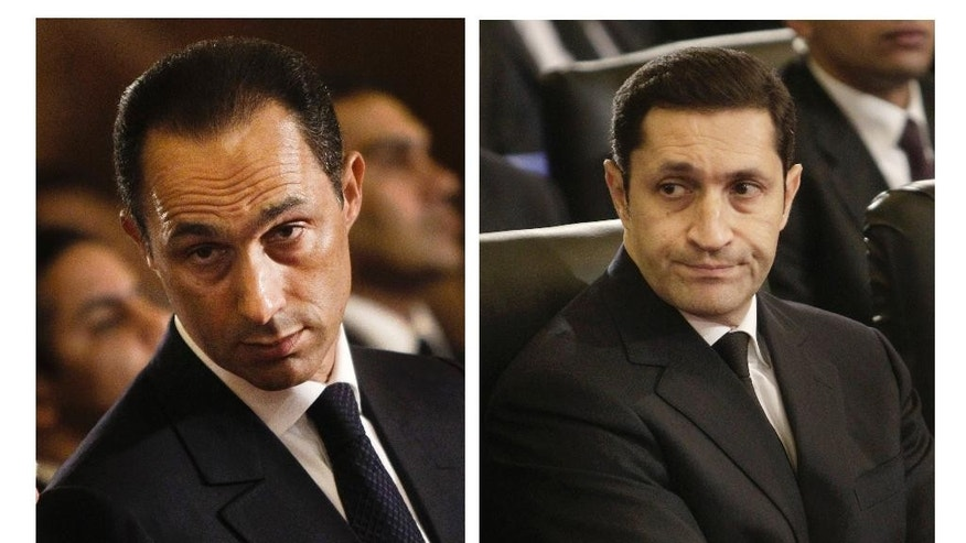FILE - This combination of Jan. 6, 2011 file images shows Gamal Mubarak, left, and Alaa Mubarak, right, attending a Christmas Eve Mass at the Coptic cathedral in Cairo, Egypt. An Egyptian court on Monday, Oct. 12, 2015, has ordered the release of the sons of deposed autocrat Hosni Mubarak, Gamal, Mubarak's one-time heir apparent, and his brother Alaa, a wealthy businessman, after time served on a corruption conviction. Their father remains held in a military hospital. (AP Photo/File)