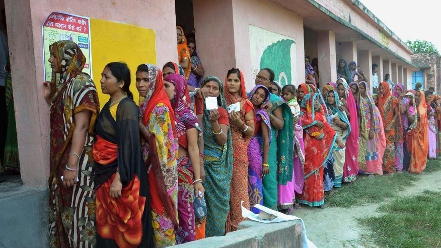 Indian women voters stand in a queue to cast their votes at a polling station during the first of the five phase voting for state legislative assembly at Samastipur district, in India's eastern state Bihar, Monday, Oct. 12, 2015. Hundreds of thousands of people lined up at polling stations in the east Indian state of Bihar on Monday for elections being seen as a referendum of Prime Minister Narendra Modi's popularity. (AP Photo/Aftab Alam Siddiqui)