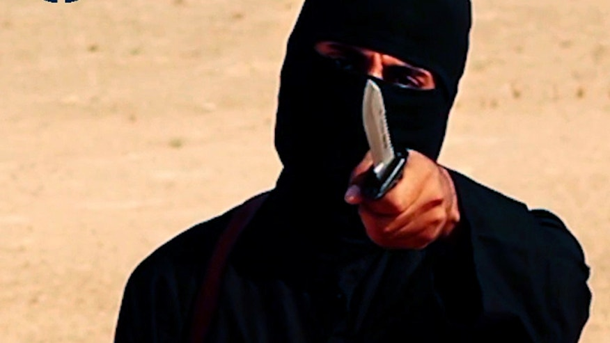 "February 26, 2015 - FILE photo of a masked militant, identified by the Washington Post as Brit Mohammed Emwazi aka ""Jihadi John,"" in an image from a 2014 video from SITE Intel Group. A Danish photographer who endured months of torture at the hands of ISIS says ""Jihadi John"" forced him to stand for days and dance the Tango at a prison in Syria."