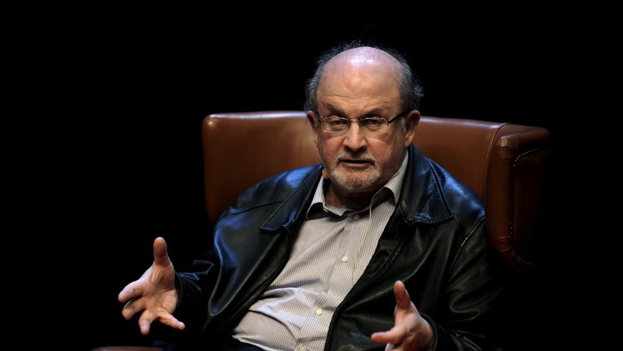"October 7, 2015 - British author Salman Rushdie at a news conference on his latest book ""Two Years Eight Months and Twenty-Eight Nights"" at the Niemeyer Center in Aviles, northern Spain. The Frankfurt Book Fair says the Iranian government has canceled plans for a national stand at this year's event to protest a planned appearance by Rushdie."
