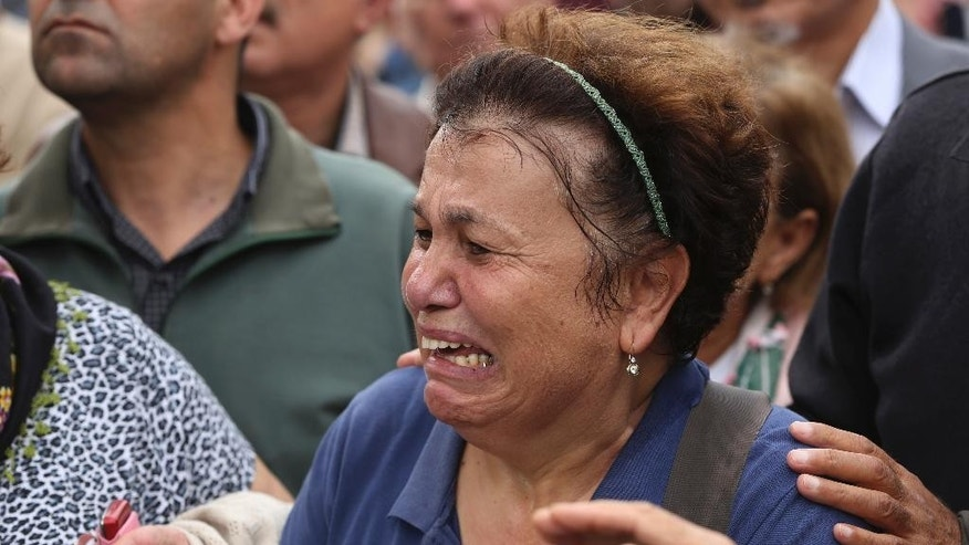 Relatives mourn over the coffin of Uygar Coskun, 32, killed in Saturday's bombing attacks, during his funeral, in Ankara, Turkey, Monday, Oct. 12, 2015. Authorities investigating the twin suicide bombings at a rally promoting peace with the Kurdish were focusing on the Islamic State group, comparing DNA samples of the suspected bombers with those obtained from families of extremists they suspect could have carried out the attacks, a newspaper close to the government reported on Monday. The government meanwhile, raised the death toll in Turkey's deadliest attack in years to 97 and said the victims included a Palestinian.  (AP Photo/Emrah Gurel)