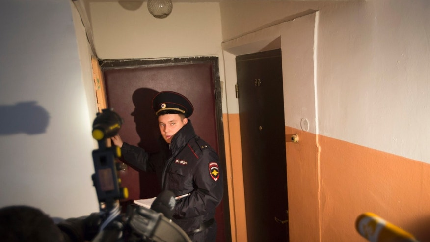 Oct. 12, 2015- Russian policeman speaks to the media in the building where homemade explosives were found in an apartment, in Moscow, Russia. Russia's counter-terrorism agency says it raided the apartment and arrested a group of people preparing to carry out an attack in the capital.