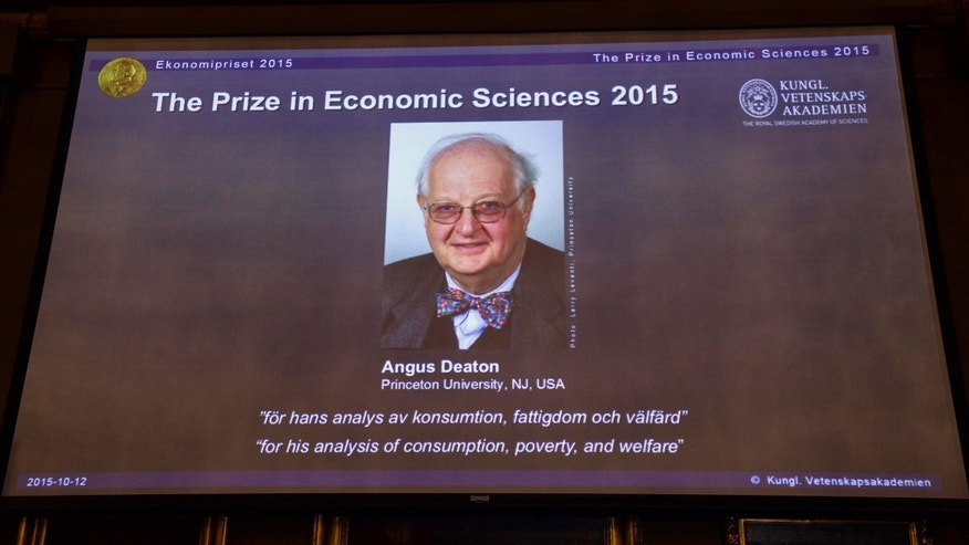 Oct. 12, 2015 - Image of Professor Angus Deaton, winner of the 2015 Nobel Prize in Economic Sciences, as the Secretary for the Royal Swedish Academy of Sciences addresses a press conference to announce the winner of the prize, in Stockholm, Sweden.