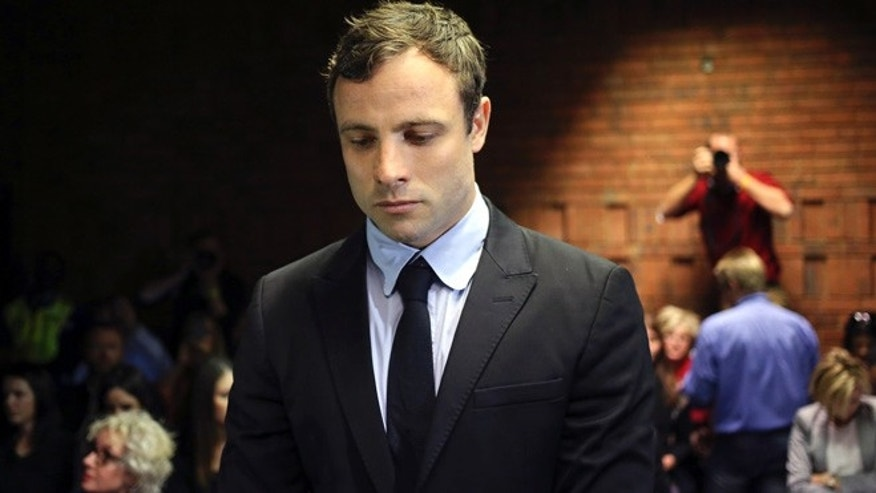 August 19, 2013: Olympic and Paralympic running star Oscar Pistorius stands during court proceedings at the Pretoria Magistrates court.
