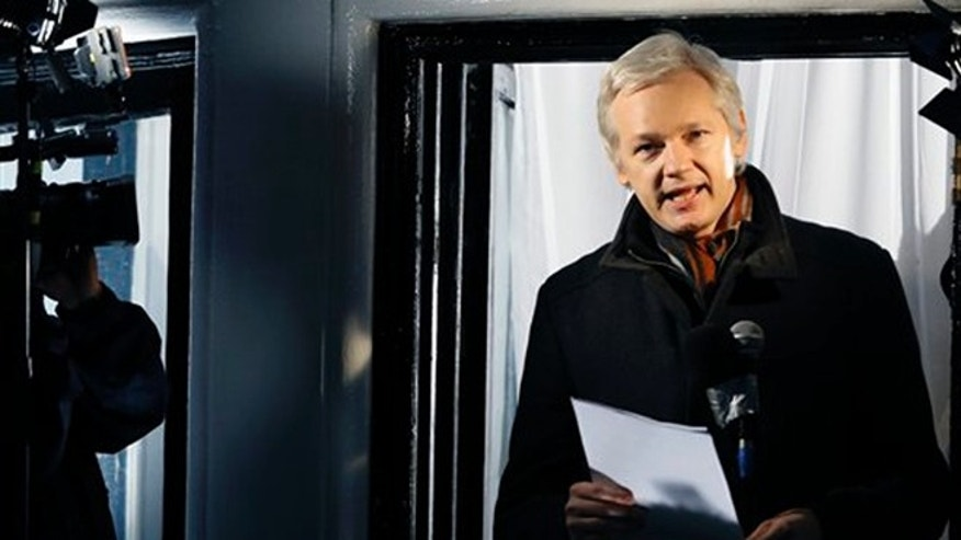 In this Thursday, Dec. 20, 2012, file photo, Julian Assange, founder of WikiLeaks speaks to the media and members of the public from a balcony at the Ecuadorian Embassy in London. (AP Photo/Kirsty Wigglesworth, File)