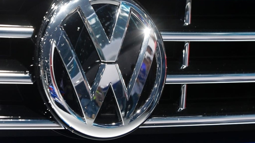 FILE - In this Sept. 22, 2015, file photo, the logo of Volkswagen at a car is photographed during the Car Show in Frankfurt, Germany. Volkswagen is recalling 1,950 diesel vehicles in China to correct engine software that the automaker has admitted cheats on emissions tests. The recall applies to 1,946 Tiguan sport utility vehicles and four Passat B6 sedans, all of them imported, the company said Monday, Oct. 12, 2015. It said technical solutions are being developed and have yet to be submitted to Chinese authorities for approval. (AP Photo/Michael Probst, File)