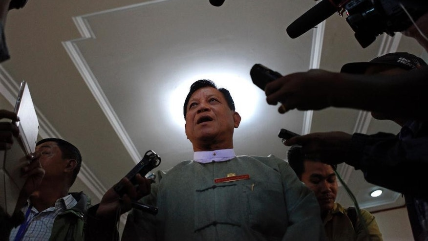 Tin Aye, chairman of Union Election Commission, talks to journalists after meeting with political parties Tuesday, Oct. 13, 2015, in Naypyitaw, Myanmar. Myanmar's election commission has proposed delaying the Nov. 8 general election either nationwide or in some areas hit by landslides and flooding. (AP Photo/Aung Shine Oo)
