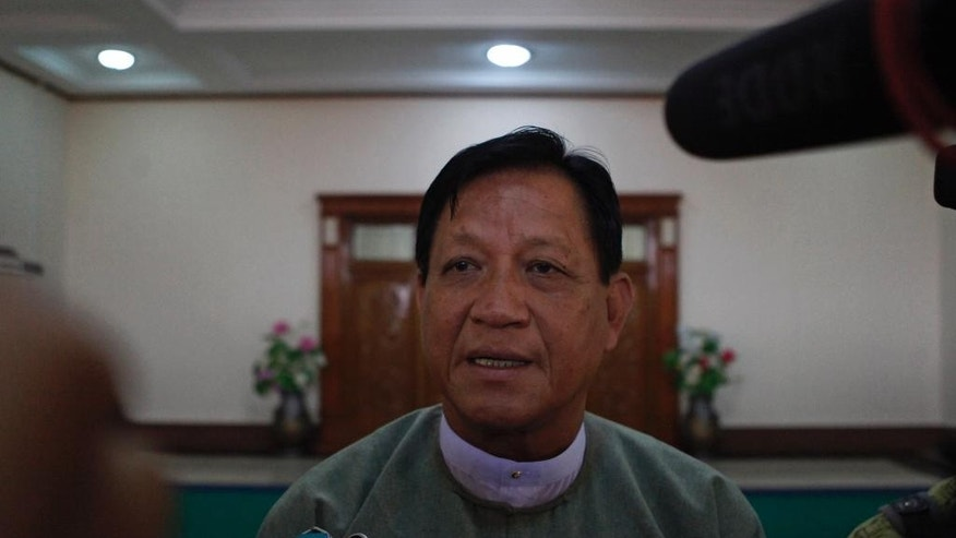Tin Aye, chairman of Union Election Commission, talks to journalists after meeting with political parties Tuesday, Oct 13, 2015, in Naypyitaw, Myanmar. Myanmar's election commission has proposed delaying the Nov. 8 general election either nationwide or in some areas hit by landslides and flooding. (AP Photo/Aung Shine Oo)