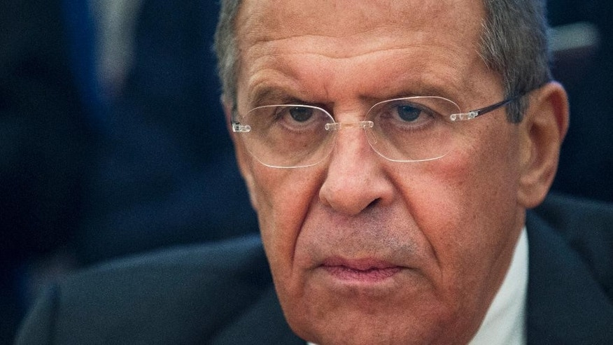 Russian Foreign Minister Sergey Lavrov listens during his meeting with U.N. Special Envoy for Syria Staffan de Mistura  in Moscow, Russia, Tuesday, Oct. 13, 2015. (AP Photo/Pavel Golovkin)