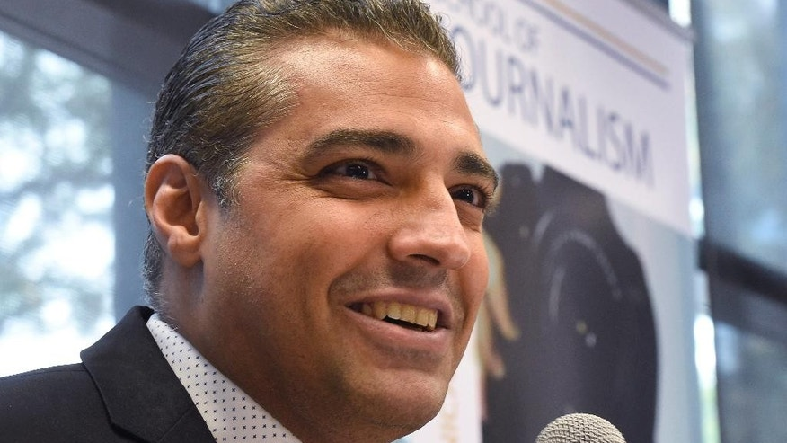 Canadian journalist Mohamed Fahmy addresses a news conference hosted by Canadian Journalists for Free Expression at Ryerson University in Toronto, Tuesday, Oct. 13, 2015.  The former Al-Jazeera journalist, who was arrested in Egypt in 2013 with two colleagues and detained on terror-related charges, arrived in Toronto on Sunday. (Frank Gunn/The Canadian Press via AP) MANDATORY CREDIT