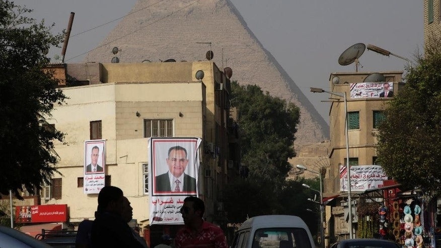"Banners of parliamentary candidate ""Mohammed Ghorab"", are seen in front of the historical site of the Giza Pyramids, near Cairo, Egypt, Wednesday, Oct. 14, 2015. Egypt's long-awaited parliamentary elections will start on Oct. 18-19, a hoped-for step toward democracy amid a harsh crackdown on dissent. The second stage of the staggered vote will take place on Nov. 22-23. Final results will be announced in early December. (AP Photo/Amr Nabil)"