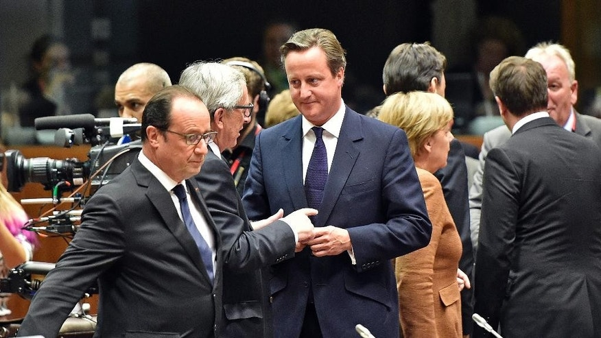FILE - In this Wednesday, Sept. 23, 2015 file photo, British Prime Minister David Cameron, center right,  listens to European Commission President Jean-Claude Juncker, center left, in Brussels. For all Britain's talk of possibly leaving the European Union unless there is fundamental change, EU leaders are increasingly frustrated with the lack of clear proposals from Prime Minister David Cameron. The issue will be discussed at an upcoming summit on Thursday, Oct. 15, 2015.(AP Photo/Martin Meissner, File)