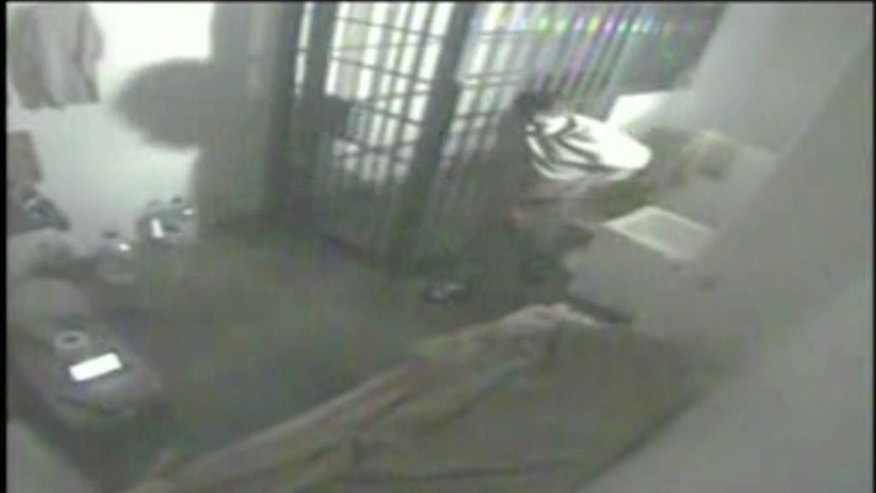 "FILE - In this file screen grab of video from a security camera, dated July 11, 2015 and released by Mexico's National Security Commission, shows the man Mexican authorities say is Joaquin ""El Chapo"" Guzman, pacing inside his cell at the Altiplano maximum security prison, shortly before escaping through a tunnel below the shower area, top right, in Almoloya, Mexico. A new closed circuit prison video broadcast Wednesday, Oct. 14, 2015, by the Mexican television chain Televisa, reveals hammering sounds several minutes before the country's most notorious drug lord escaped from his cell through a tunnel. (Mexico's National Security Commission via AP, File)"
